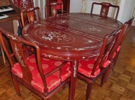 Rosewood, mother of pearl inlaid dining table with 6 chairs and 2 leaves