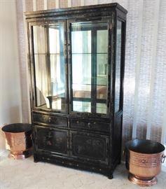 Black lacquer curio cabinet. Copper planters