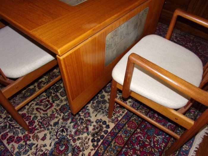 Beautiful vintage Benny Linden Danish MCM teak chairs (6 chairs plus 2 captains). Drop-down dining room table with stone tile inlay.