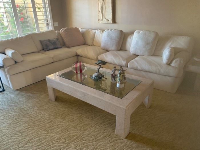 Sectional sofa and stone and glass coffee table