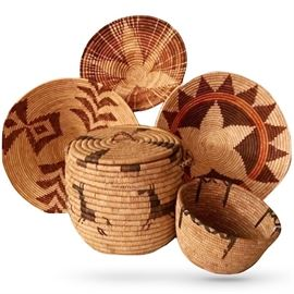 A few Native American baskets, many coiled, some twined