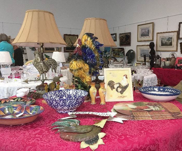 Americana tables include rooster lamps, ceramic and metal roosters and two 1969 Dante Distillery ceramic flasks — one with CA quail and one with a prairie chicken — and a Pat Espey bowl and plate.