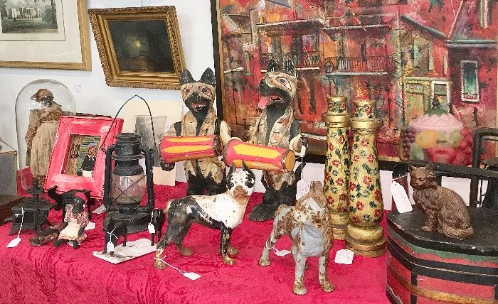 Outsider art and Black Americana include two carved wolf or dog drummers from a North Carolina vendor; antique Hubley dogs and horses; handmade cloth dolls: a folk art handled bandbox-style lidded box; brightly painted vintage folk art candle holders and folk art baskets and carved figures.