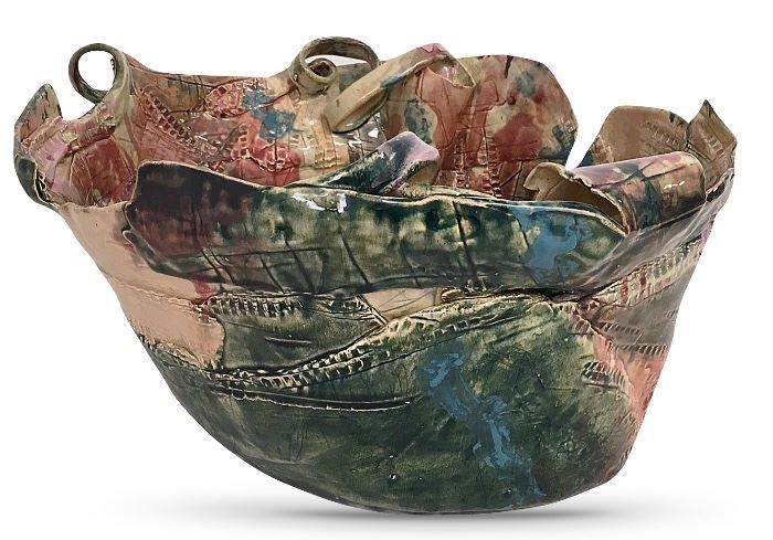 """An amish ceramic art bowl, about 14"""" at the widest and 8"""" tall; gallery label indicates the colors evoke  quiet reflection and the shape recalls the free movements of nature"""