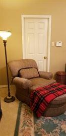 Elegant lounger and antique floor lamp