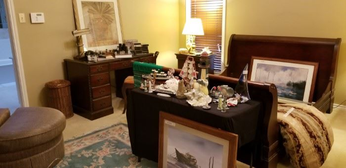 Master king bed frame,  two nightstands and Duncan desk . Lots of nautical decor and shells