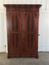Beautiful Empire flame mahogany armoire, 7 1/2 ' tall.  Have carved molding for top as shown in next old photo.