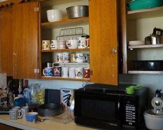 Microwave, pizza maker, cups, pans, kitchen