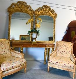 Stunning pair of gilt mirrors in Rococco style with beautiful pair of chairs.