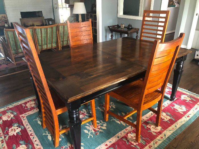 Antique solid wood dining table with leaf with high-back ladder chairs