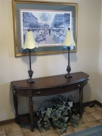 Demilune entry table, 2 candlestick lamps, Parisian art scene