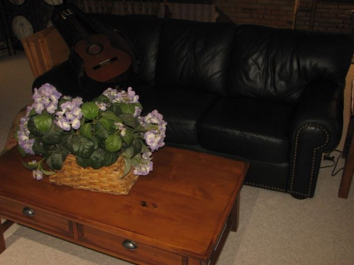 Green leather sofa with brass nailheads, pine coffee table