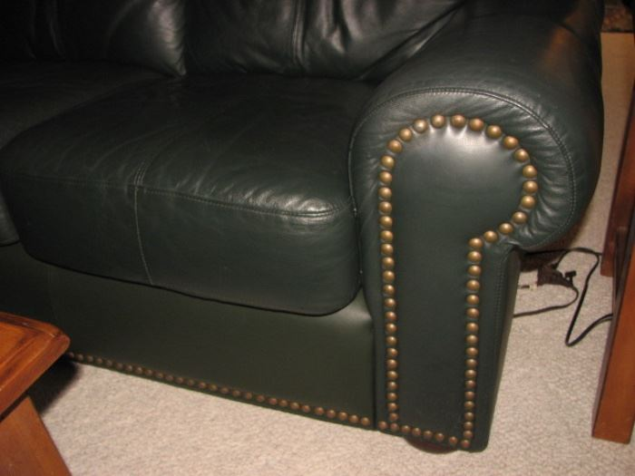 Green leather sofa with brass nailheads