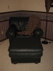 Green leather chair & ottoman with brass nailheads
