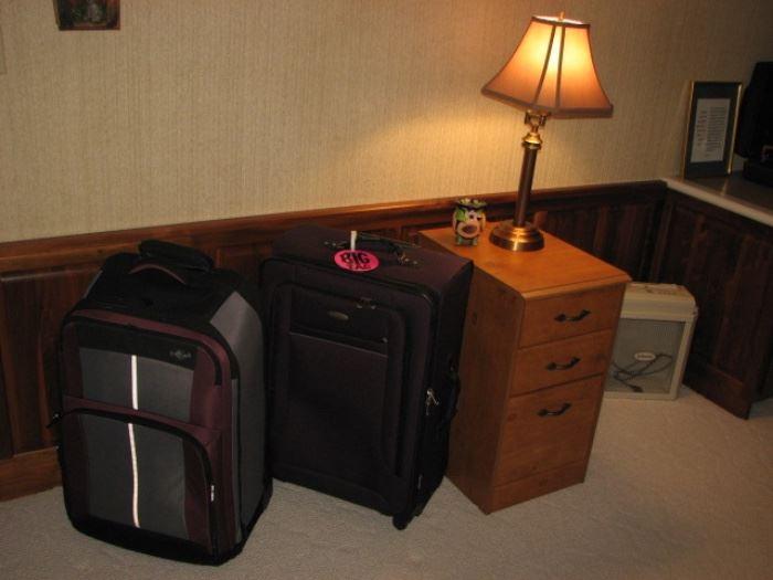 luggage, wood file cabinet