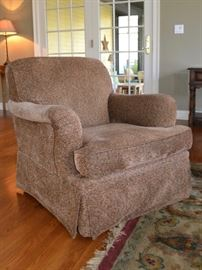 One of two Furniture Guild swivel chairs