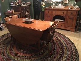 Willett drop leaf oval dining table, with leaf solid maple with 4 chairs (1 armchair and 3 sidechairs)
