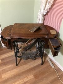 Beautiful Treadle sewing machine, all books and extra parts included!!  Machine and table are a matched set both Eldridge, back arm of machine says Improved Eldridge B