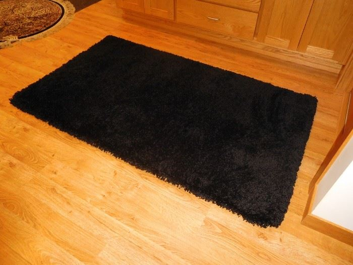 never used shag black rug