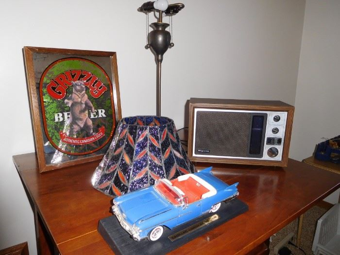 Grizzly light mirror, Magnavox radio, Cadillac Eldorado model car, tiffany lamp that needs a little TLC