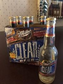 6 unopened bottles Miller Clear