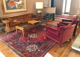 Large brass lamps and painting above sofa are not for sale