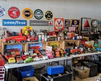 Selection of vintage and reproduction gas and oil signage.  vintage toys and more!