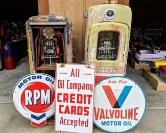 Selection of porcelain and steel signs. Selection of Tokheim, Wayne, Bennett Gas Pumps for restoration and restored condition.