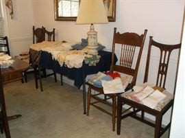 Pressed back oak chairs and lots of linens