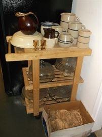 Wooden kitchen cart with stoneware pitchers