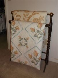 Quilt rack and two cross stitched quilts