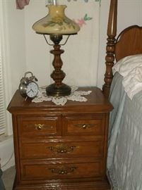 One of a pair of bedside table by Stanley Furniture
