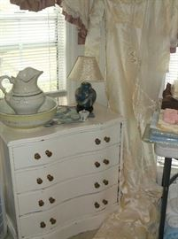 Small white paint serpentine front chest and vintage wedding gown