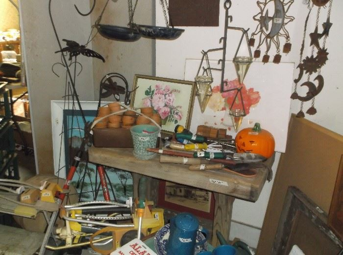 Wind chimes, bird feeders, potting table