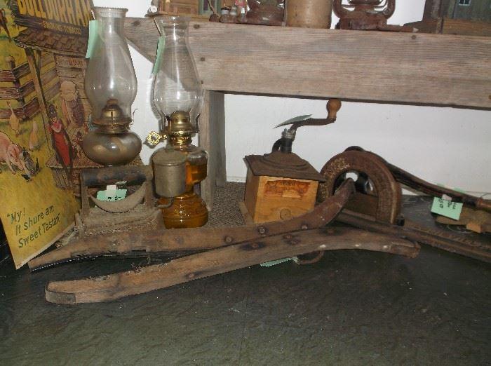 Oil lamps, coffee grinder, tobacco cutter, mule hames