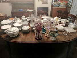 """Just some of the outstanding glassware and porcelain, on the dining room table (48"""" round plus two foot-long leaves, 4 chairs)."""