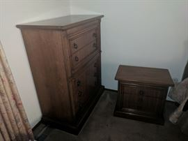 Bedside stand and highboy dresser from the bedroom set.