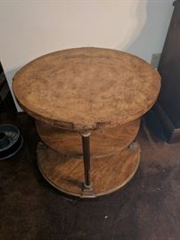 "Weiman 26"" diameter occasional table with metal columns."