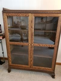 old carved curio/bookcase