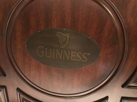 GUINNESS BAR AND PAIR OF STOOLS IN DISTRESSED WALNUT.