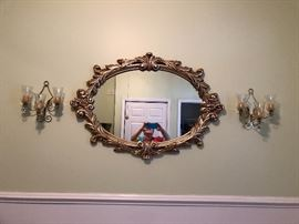 Decorative gold framed mirror and two gold wall sconces