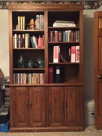 Hand crafted solid oak book shelf. Hand blown glass and large selection of books.