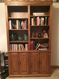 Hand crafted solid oak book shelf with hand blown glass sculptures, assorted books and book ends