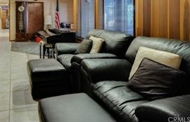 Black leather chairs with Ottomans. Ridgeway grandfather clock.