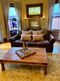 Hand knotted wool rugs, leather furniture, one of a kind artisan made furniture, and more!