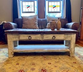 Rustic upcycled coffee table and Restoration Hardware wool rug...rug measures 6'x10'.