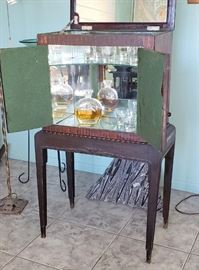 1930's Liquor Cabinet, mirrored inside, lid opens - excellent vintage condition.