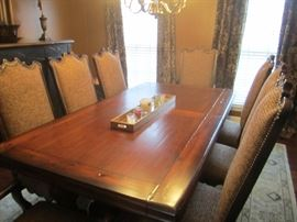 VERY NICE TABLE WITH 2 LEAVES AND 2 ARM AND 6 SIDE CHAIRS FROM OOH LA LA