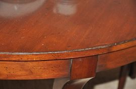 Gorgeous old world mahogany finish with apron side details!