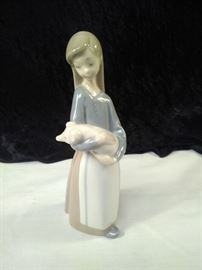 Lladro girl with pig https://ctbids.com/#!/description/share/110010